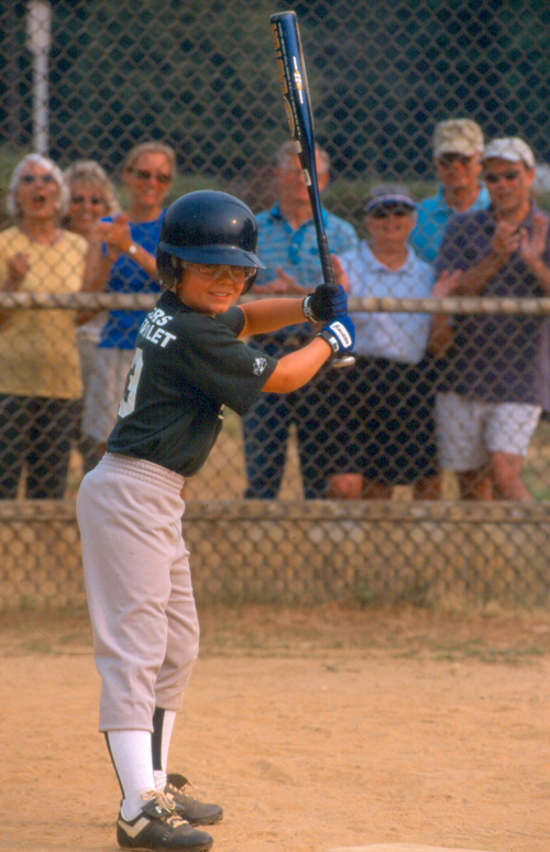 Boy playing baseball image