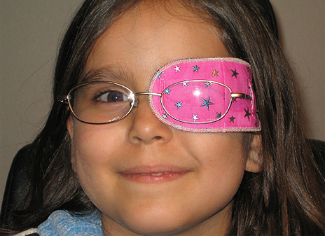 Girl with pink eye patch image