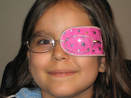 Child with pink eye patch image